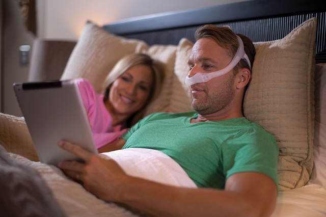 This photo shows someone wearing a Philips DreamWear mask